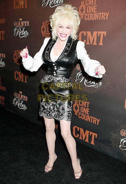 """DOLLY PARTON.Arrivals at """"CMT Giants"""" Honoring Reba McEntire held at the Kodak Theatre, Hollywood, LA, California, USA,.26 October 2006..full length black leather top waistcoat skirt white top shirt hands gesture funny waving arms.Ref: ADM/RE.www.capitalpictures.com.sales@capitalpictures.com.©Russ Elliot/AdMedia/Capital Pictures."""