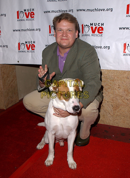 ANDY RICHTER.The 3rd Annual Much Love Animal Rescue Celebrity Comedy Benefit held at The Laugh Factory in Hollywood, California .September 29, 2004.full length, dog, pet, animal, kneeling, crouching.www.capitalpictures.com.sales@capitalpictures.com. Copyright 2004 by Debbie VanStory