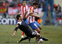 Atletico de Madrid's Eduardo Salvio (r) and Lazio's Luciano Zauri during Europa League match.February 23,2012. (ALTERPHOTOS/Acero) .Atletico Madrid Lazio Europa League.Italy Only
