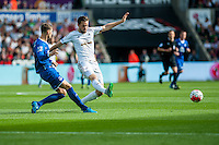 Gylfi Sigurosson of Swansea  kicks the ball to wide during the Barclays Premier League match between Swansea City and Everton played at the Liberty Stadium, Swansea  on September 19th 2015