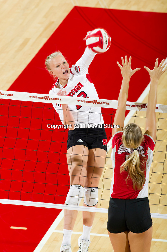 Wisconsin Badgers Julie Mikaelsen (12) during an NCAA women's college volleyball game against the Ohio State Buckeyes on November 4, 2011. The Buckeyes won 3-1. (Photo by David Stluka)
