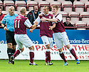 Arbroath's Steven Milne celebrates with Paul Sheerin (11) and Alan Cook (7) after he scores their first goal.