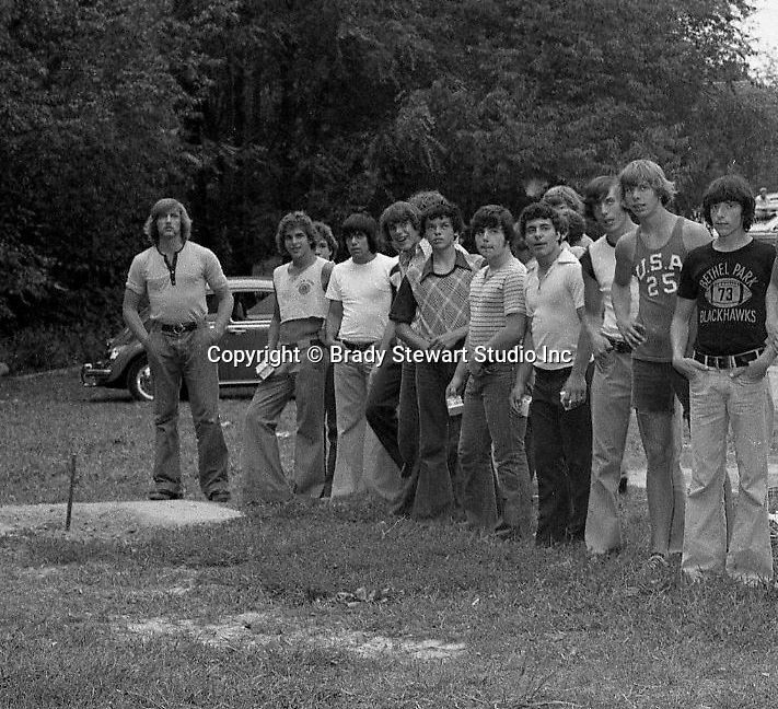 Bethel Park PA: View of members of the Bethel Park High School football team playing horseshoes during the annual Bethel Park Athletic Association (BPAA) picnic at Lyons Park. Included in the photo are David Lorash (Right) and Craig Streiner (in Middle)<br />