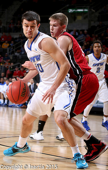 SIOUX FALLS, SD - MARCH 8: Max Landis #10 of IPFW drives against Casey Kasperbauer #14 of USD in the first half of their second round Summit League Championship Tournament game Sunday evening at the Denny Sanford Premier Center in Sioux Falls, SD.    (Photo by Dave Eggen/Inertia)
