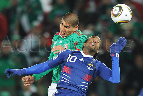 18 06 2010 Mexico's CarlSalcido l with France's Andr預ierre Gignac. FIFA World Cup, Group A, France v Mexico, Peter Mokaba Stage, South Africa, June 17th, 2010. Mexico Won 2-0