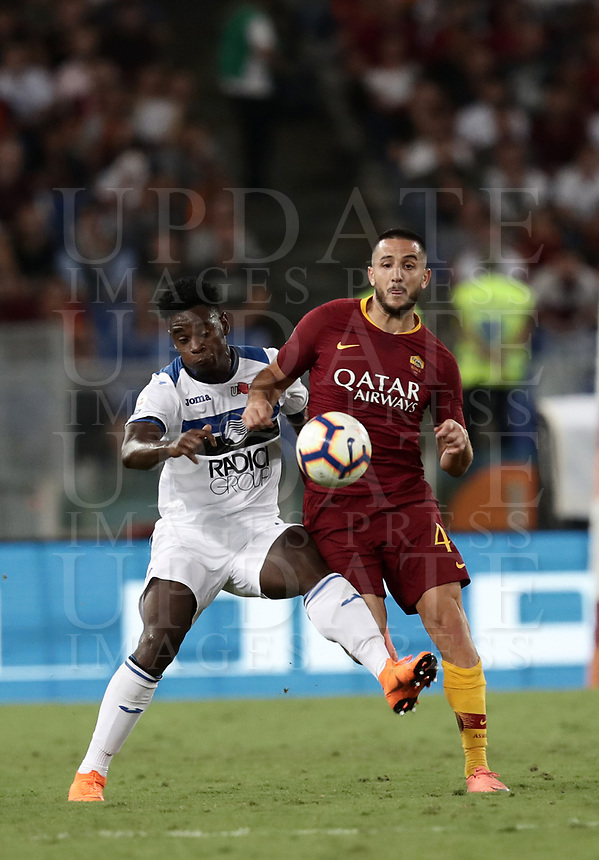 Calcio, Serie A: Roma - Atalanta, Stadio Olimpico, 27 agosto, 2018.<br /> Roma's Kostas Manolas (r) in action with Atalanta's Duvan Zapata (l) during the Italian Serie A football match between Roma and Atalanta at Roma's Stadio Olimpico, August 27, 2018.<br /> UPDATE IMAGES PRESS/Isabella Bonotto