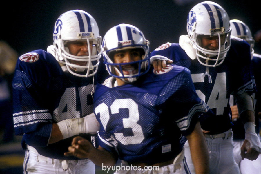 80Holiday Sikahema<br /> <br /> Holiday Bowl vs Washington. 45 Mike Lacy. 54 Jay Sample. 23 Vai Sikahema.<br /> <br /> December 19, 1980<br /> <br /> Photo by Mark Philbrick/BYU<br /> <br /> &copy; BYU PHOTO 2009<br /> All Rights Reserved<br /> photo@byu.edu  (801)422-7322