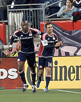 New England Revolution midfielder Diego Fagundez (14) celebrates his goal with New England Revolution midfielder Kalifa Cisse (4).In a Major League Soccer (MLS) match, the New England Revolution (blue/red) defeated Philadelphia Union (blue/white), 2-0, at Gillette Stadium on April 27, 2013.