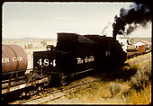 D&amp;RGW #484 K-36 with water car. Gondolas with pipe to right ahead.<br /> D&amp;RGW  Farmington area ?, NM