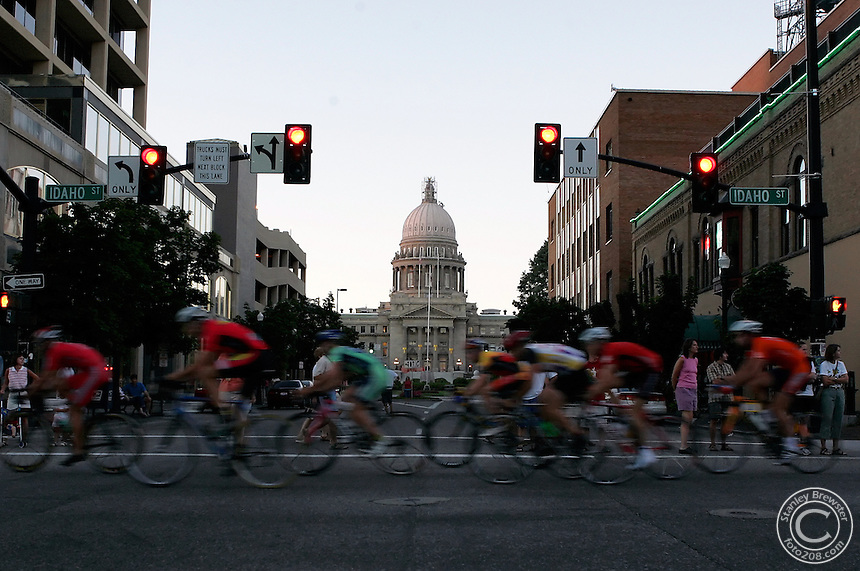 Boise, ID.  7-23-05   Racers pass in front of the state capitol Friday night during the Ninteenth annual Twilight Criterium in downtown Boise.