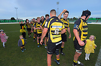 Yellows players celebrate winning the 2019 Manawatu premier club rugby Hankins Sheild final match between Varsity and Feilding Yellows at CET Arena in Palmerston North, New Zealand on Saturday, 13 July 2019. Photo: Dave Lintott / lintottphoto.co.nz