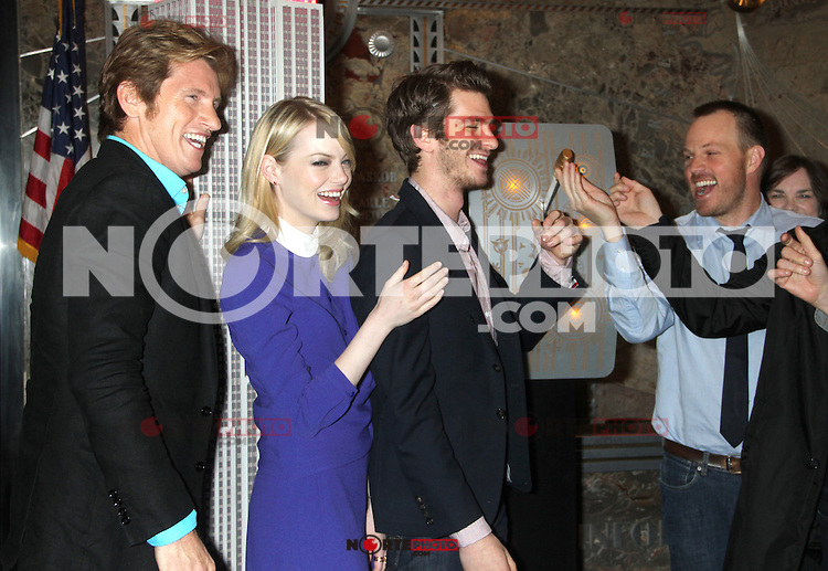 June 25, 2012 Denis Leary, Emma Stone and Andrew Garfield, of The Amazing Spider-man film, attend the lighting ceremony  to support Stand Up to Cancer at the Empire State Building in New York City. © RW/MediaPunch Inc. **NORTEPHOTO.COM*<br />
