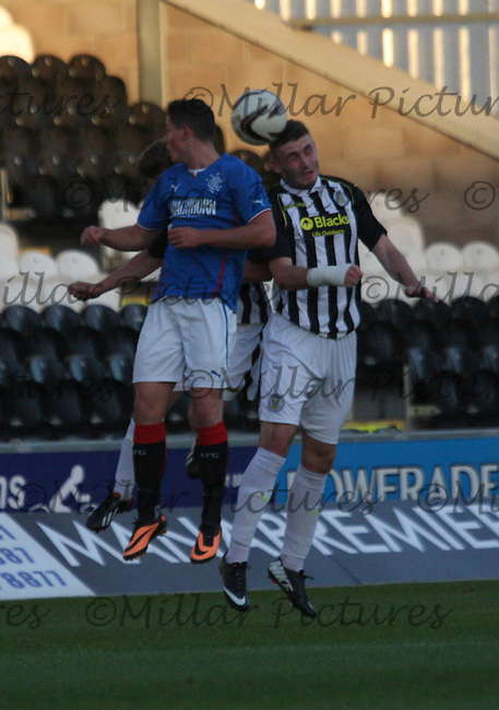 Fraser Aird (left) and Jason Naismith challenge in the air in the St Mirren v Rangers Scottish Professional Football League Under 20 match played at St Mirren Park, Paisley on 10.9.13.