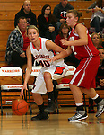 SIOUX FALLS, SD: DECEMBER 20: Peyton Vandebrake #40 from Washington drives against Morgan Tessier #32 from Yankton in the the first half of their game Friday night at Washington. (photo by Dave Eggen/Inertia)