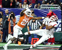 NWA Media/Michael Woods --12/29/2014-- w @NWAMICHAELW...University of Arkansas receiver Demetrius Wilson makes a touchdown catch in front of Texas defender Duke Thomas in the 2nd quarter in the Texas Bowl Monday night at  NRG Stadium in Houston.