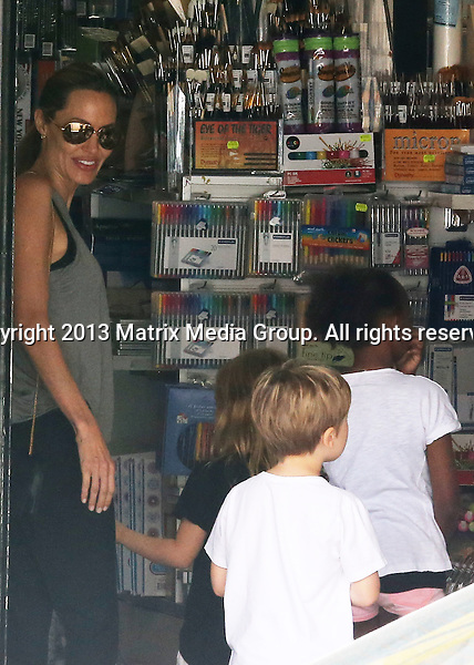 7 DECEMBER 2013 SYDNEY AUSTRALIA<br /> <br /> NON EXCLUSIVE <br /> <br /> Angelina Jolie pictured with her children in Rose Bay on a Saturday morning shopping expedition to the Berkelou book store and a toy shop.<br /> <br /> *No internet without clearance*<br /> MUST CALL PRIOR TO USE .<br /> +61 2 9211-1088<br /> Matrix Media Group<br /> Note: All editorial images subject to the following: For editorial use only. Additional clearance required for commercial, wireless, internet or promotional use.Images may not be altered or modified. Matrix Media Group makes no representations or warranties regarding names, trademarks or logos appearing in the images.