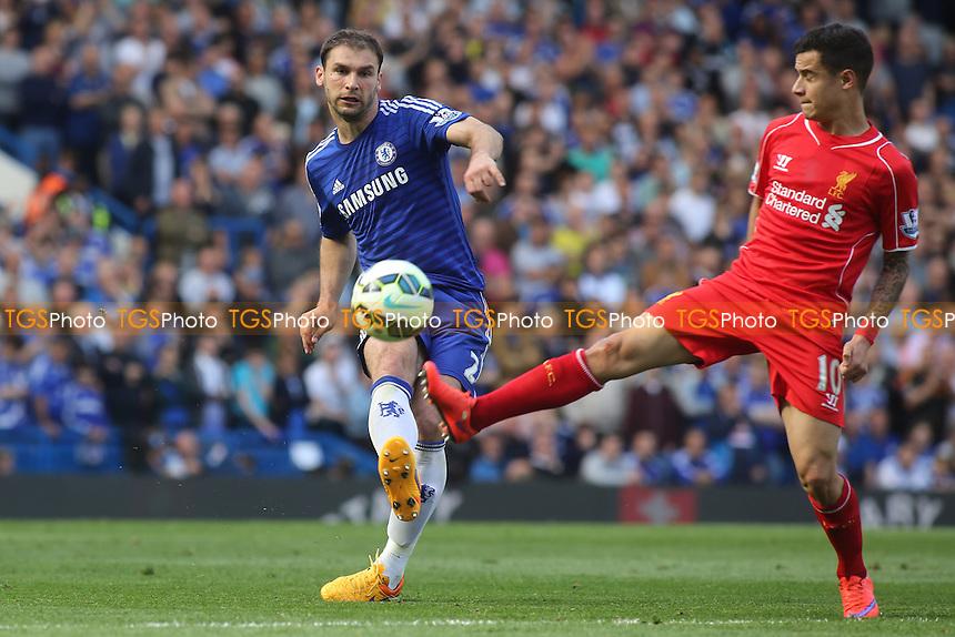 Liverpool's Philippe Coutinho tackles Chelsea's  Branislav Ivanovic - Chelsea vs Liverpool - Barclays Premier League Football at Stamford Bridge, London - 10/05/15 - MANDATORY CREDIT: Paul Dennis/TGSPHOTO - Self billing applies where appropriate - contact@tgsphoto.co.uk - NO UNPAID USE