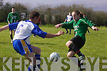 Fenit Samphires full back Paul Moloney tries to control the bouncing ball before Mainebans Maurice Flaherty intervenes in their Premier League clash in Keel on Sunday..