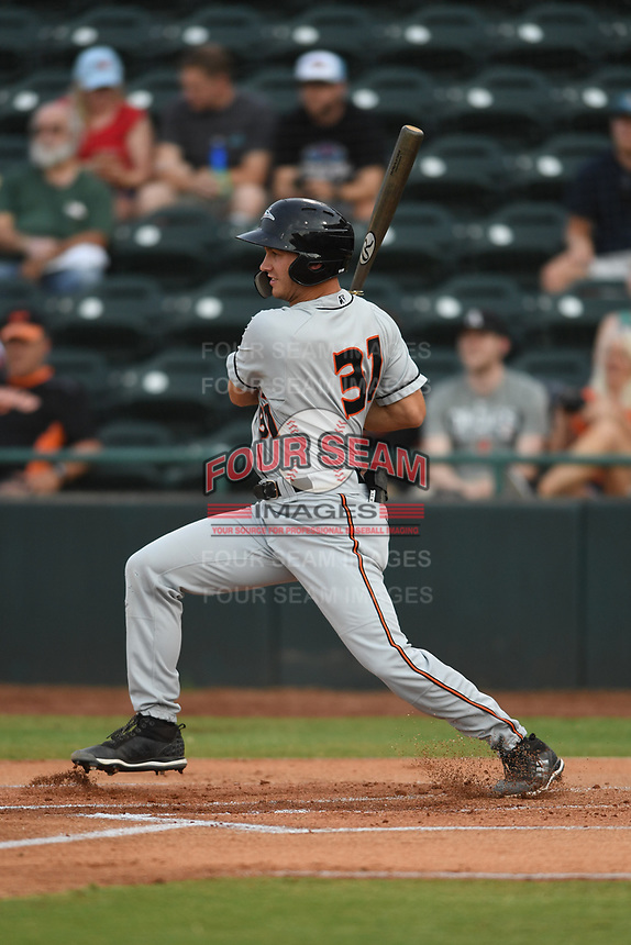 Shayne Fontana (31) of the Delmarva Shorebirds follows through on his swing during game one of the Northern Division, South Atlantic League Playoffs against the Hickory Crawdads at L.P. Frans Stadium on September 4, 2019 in Hickory, North Carolina. The Crawdads defeated the Shorebirds 4-3 to take a 1-0 lead in the series. (Tracy Proffitt/Four Seam Images)