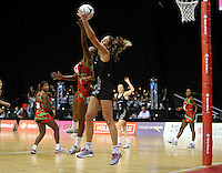 31.10.2013 Silver Fern Irene Van Dyk and Malawi's Towela Vinkhumbo in action during the Silver Ferns V Malawi during the New World Netball Series played at the Claudelands Arena in Hamilton. Mandatory Photo Credit ©Michael Bradley.