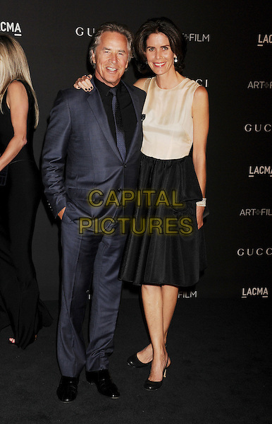 LOS ANGELES, CA - NOVEMBER 01: Actor Don Johnson (L) and Kelley Phleger attend the 2014 LACMA Art + Film Gala honoring Barbara Kruger and Quentin Tarantino presented by Gucci at LACMA on November 1, 2014 in Los Angeles, California.<br /> CAP/ROT/TM<br /> &copy;Tony Michaels/Roth Stock/Capital Pictures