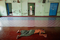 A Myanmar Rohingya man sleeps at a mosque in the village of Gollyadeil north of the town of Sittwe May 19, 2012. REUTERS/Damir Sagolj (MYANMAR)