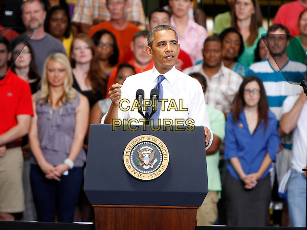 President Barack Obama made a stop at Amazon's Distribution Center in Chattanooga, where he spoke to the gathered crowd about jobs creation and lowering the unemployment rate. Amazon recently announced the addition of 7000 new jobs, Chattanooga, TN., USA.<br /> July 30th, 2013<br /> half length white shirt blue tie podium speech <br /> CAP/ADM/DH<br /> &copy;Dan Harr/AdMedia/Capital Pictures