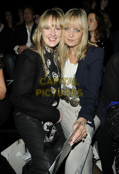 CARLEY LAWSON & TWIGGY LAWSON.At the Sass & Bide Fashion Show during Day 1 of London Fashion Week, BFC Show Space, Somerset House, London, England, UK, February 19th 2009..LFW half length front row sitting family mother daughter mom mum black jacket trousers grey gray navy blue Alexander McQueen skull print scarf .CAP/CAN.©Can Nguyen/Capital Pictures