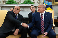 US President Donald J. Trump (R) and Prime Minister of Bulgaria Boyko Borisov (L) shake hands while delivering remarks to members of the news media during their meeting in the Oval Office of the White House in Washington, DC, USA, 25 November 2019. Trump hosts Borisov to discuss security among the NATO allies and stability in the Black Sea region.<br /> Credit: Michael Reynolds / Pool via CNP/AdMedia