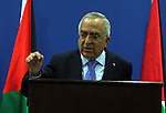 Palestinian Prime Minister Salam Fayyad addressing the media during a press conference at his office in the West Bank town of Ramallah, about the results of the donors meeting held in Brussels, on 14 April 2011, Fayyad mentions the headlines of the reports issued by the United Nations and the World Bank and International Monetary Fund. Fayyad said that the emphasis on the international recognition of the readiness of the Palestinian National Authority institutions will lead to the birth of the State of Palestine. Photo by Issam Rimawi