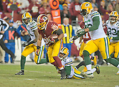 Washington Redskins running back Chris Thompson (25) is tackled by Green Bay Packers cornerback Damarious Randall (23) in second quarter action during an NFC Wild Card game at FedEx Field in Landover, Maryland on Sunday, January 10, 2016.  Following on the play are Green Bay Packers free safety Ha Ha Clinton-Dix (21) and Green Bay Packers outside linebacker Julius Peppers (56).  The Packers won the game 35 - 18.<br /> Credit: Ron Sachs / CNP