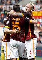 Calcio, Serie A: Roma vs ChievoVerona. Roma, stadio Olimpico, 8 maggio 2016.<br /> Roma's Miralem Pjanic, center, celebrates with teammates Francesco Totti, left, and Radja Nainggolan after scoring  during the Italian Serie A football match between Roma and ChievoVerona at Rome's Olympic stadium, 8 May 2016.<br /> UPDATE IMAGES PRESS/Isabella Bonotto