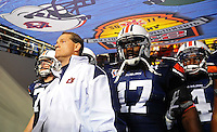 Jan 10, 2011; Glendale, AZ, USA; Auburn Tigers head coach Gene Chizik leads his team to the field before the 2011 BCS National Championship game against the Oregon Ducks at University of Phoenix Stadium.  Mandatory Credit: Mark J. Rebilas-
