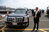 "Security detail guard access to the tarmac where Marine One (on left) carrying United States President Barack Obama and First Lady Michelle Obama prepares for departure from the Downtown Manhattan/Wall Street Heliport towards JFK Airport in New York New York, on September 29, 2015.  In the foreground is the presidential limousine, also known as ""The Beast."" <br /> Credit: Anthony Behar / Pool via CNP"