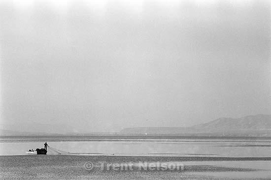 Fishermen on boat in Utah Lake.<br />