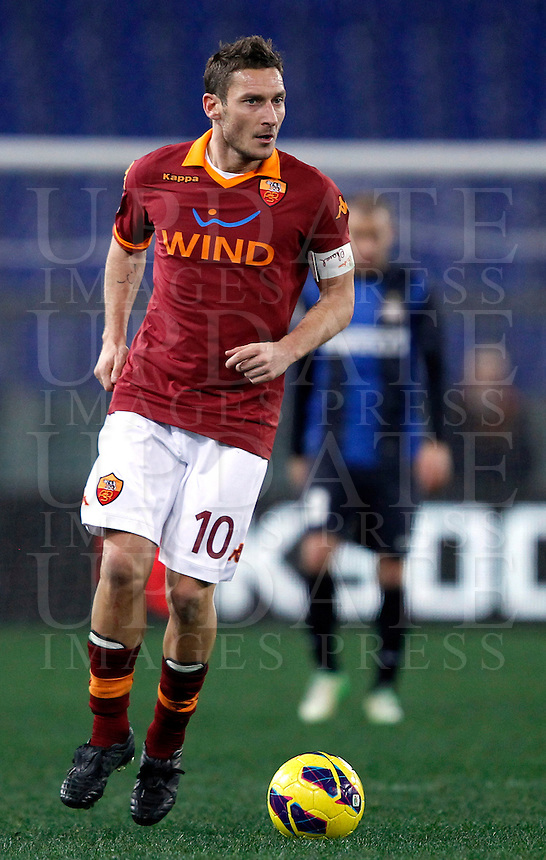 Calcio, semifinale di andata di Coppa Italia: Roma vs Inter. Roma, stadio Olimpico, 23 gennaio 2013..AS Roma forward Francesco Totti in action during the Italy Cup football semifinal first half match between AS Roma and FC Inter at Rome's Olympic stadium, 23 January 2013..UPDATE IMAGES PRESS/Isabella Bonotto