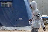 Migranti nella tendopoli allestita presso la stazione Tiburtina a Roma, 16 giugno 2015.<br /> A migrant walks in the tent camp set up near the Tiburtina railway station in Rome, 16 June 2015. Italy is facing a huge flow of migrants brought to Sicily after rescue at sea, many of whom are trying to join their relatives in northern Europe. <br /> UPDATE IMAGES PRESS/Riccardo De Luca
