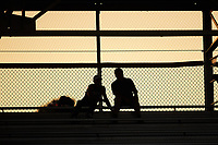 A couple of fans sit in the top row of seats behind home plate during the Appalachian League game between the Johnson City Cardinals and the Burlington Royals at Burlington Athletic Stadium on September 4, 2019 in Burlington, North Carolina. The Cardinals defeated the Royals 8-6 to win the 2019 Appalachian League Championship. (Brian Westerholt/Four Seam Images)