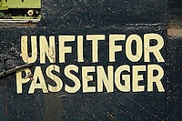 Unfit for passengers sign on train parked at train station, Udaipur, India.