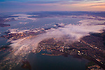 Aerial at sunrise over fog above Richmond, California