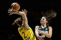 Melbourne, 15 August 2015 - Chevannah PAALVAST of New Zealand and Belinda SNELL of Australia fight for the ball in game one of the 2015 FIBA Oceania Championships in women's basketball between the Australian Opals and the New Zealand Tall Ferns at Rod Laver Arena in Melbourne, Australia. Aus def NZ 61-41. (Photo Sydney Low / sydlow.com)