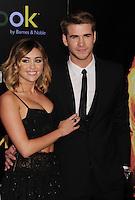 LOS ANGELES, CA - MARCH 12: Miley Cyrus and Liam Hemsworth  attend 'The Hunger Games' World Premiere at Nokia Theatre at LA Live on March 12, 2012 in Los Angeles, California. /NortePhoto.com<br /> <br /> **CREDITO*OBLIGATORIO** *No*Venta*A*Terceros*<br /> *No*Sale*So*third*