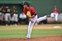 Elizabethton Twins pitcher Kuo Hua Lo #44 delivers a pitch during a game against the  Bristol Pirates at Joe O'Brien Field June 30, 2014 in Elizabethton, Tennessee. The Twins defeated the Pirates 8-5 in game one of a double header. (Tony Farlow/Four Seam Images)
