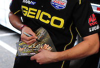 Jun. 3, 2012; Englishtown, NJ, USA: Detailed view as NHRA top fuel dragster driver Morgan Lucas signs autographs during the Supernationals at Raceway Park. Mandatory Credit: Mark J. Rebilas-