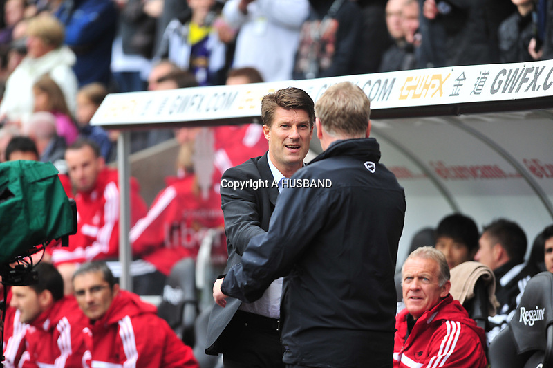 Swansea v Manchester UnitedPlayed at the Liberty Stadium, SwanseaBarclays Premier League 2013-08-17Manchester United take on Swansea city in their first game of the Premier League 2013/2014 season at the Liberty Stadium. Swansea manager David Laudrup shaking hands with Manchester united manager David Moyes