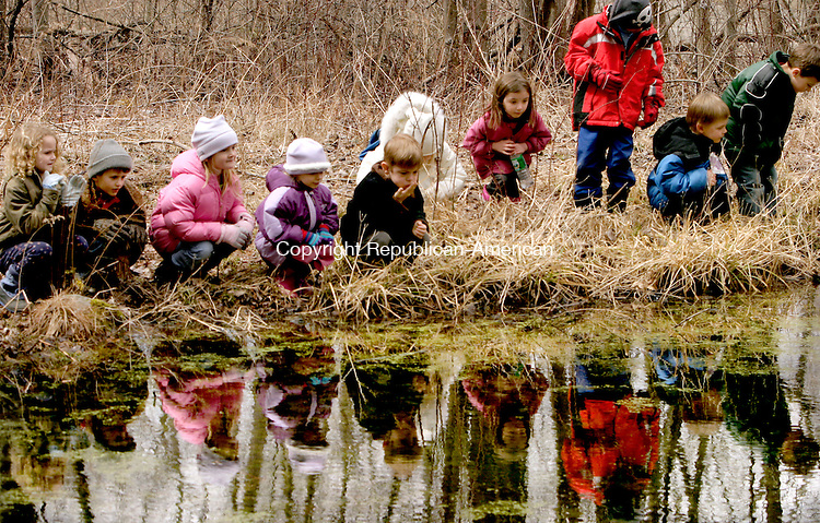 WOODBURY, CT--05 APRIL 2007--040507JS06-Students looks for wood frogs and spring peepers in the vernal pond at Flanders Nature Center in Woodbury during Thursday's Children's Farming program. FOR COUNTRY LIFE<br /> Jim Shannon / Republican-American