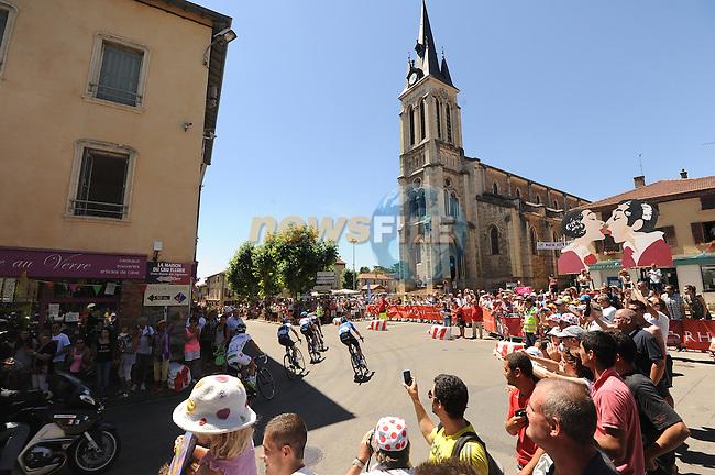 The breakaway group of Simon Clarke (AUS) Orica GreenEdge, Florian Vachon (FRA) Bretagne-Seche, David De La Cruz Melgarejo (ESP) Netapp-Endura, Gregory Rast (SUI) Trek Factory Racing and Sebastian Langeveld (NED) Garmin-Sharp pass Beaujolais country during Stage 12 of the 2014 Tour de France running 185.5km from Bourg-en-Bresse to Saint Etienne. 17th July 2014.<br /> Photo ASO/B.Bade/www.newsfile.ie