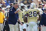 Head coach Paul Johnson of the Georgia Tech Yellow Jackets talks to running back Dedrick Mills #26 during the first half of the TaxSlayer Bowl against the Kentucky Wildcats at EverBank Field on Saturday, December 31, 2016 in Jacksonville, Florida. Photo by Michael Reaves | Staff.