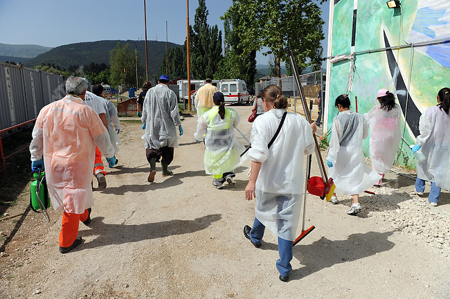 In the camp of piazza d'Armi in L'Aquila, where 1,300 people who lost their homes in the Abruzzo earthquake in April are now living in tents, a team of volunteers cleaned the shower cabins and toilets. May 22, 2009
