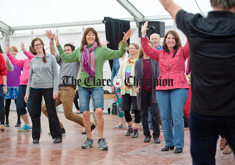 Enthusiastic students take part in a dance class as part of the Willie Clancy Summer school in Miltown Malbay. Photograph by John Kelly.